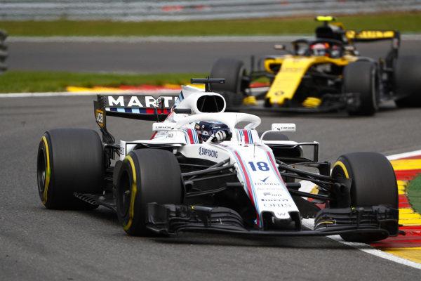 Lance Stroll, Williams FW41, leads Carlos Sainz Jr., Renault Sport F1 Team R.S. 18.