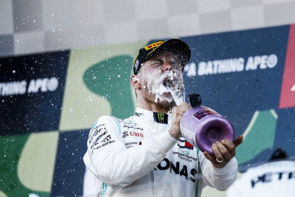 Valtteri Bottas, Mercedes AMG F1, 1st position, drinks Champagne on the podium
