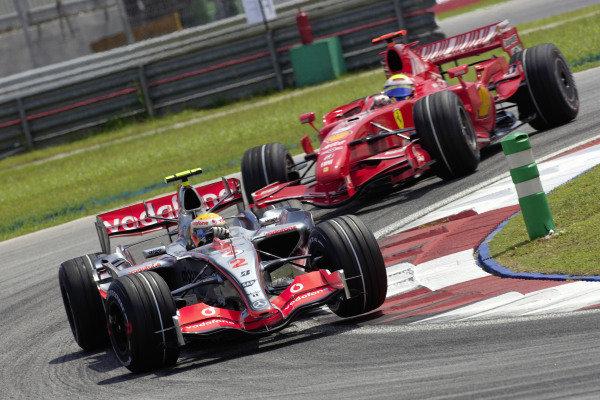 Lewis Hamilton, McLaren MP4-22 Mercedes leads Felipe Massa, Ferrari F2007.
