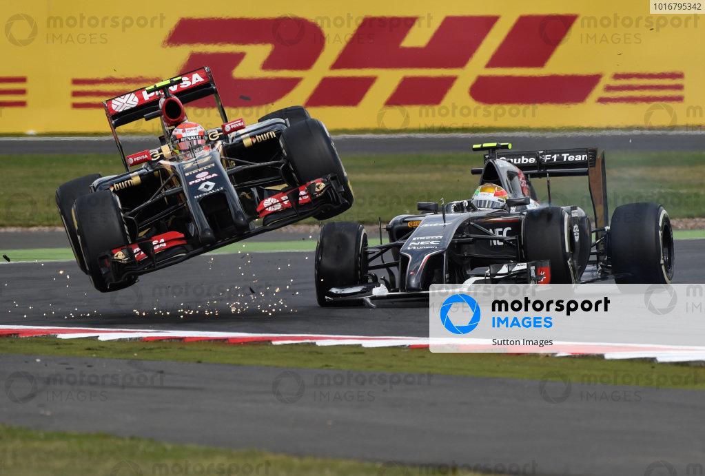 (L to R): Pastor Maldonado (VEN) Lotus E22 gets airborne alongside Esteban Gutierrez (MEX) Sauber C33. Formula One World Championship, Rd9, British Grand Prix, Race Day, Silverstone, England, Sunday 6 July 2014. BEST IMAGE