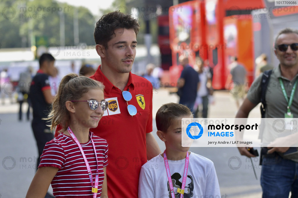 Charles Leclerc, Ferrari takes a photograph with young fans