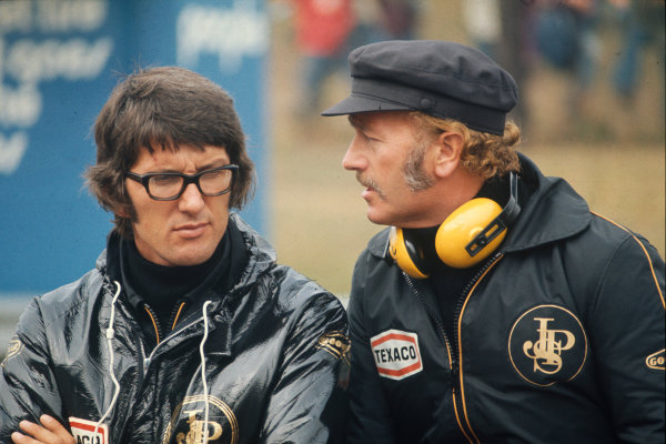 Monza, Italy. 7th - 9th September 1973.Peter Warr, Team Manager and Director, Team Lotus talks with Colin Chapman, founder and Team Owner, portrait.World Copyright: LAT Photographic.Ref:  Colour Transparency.