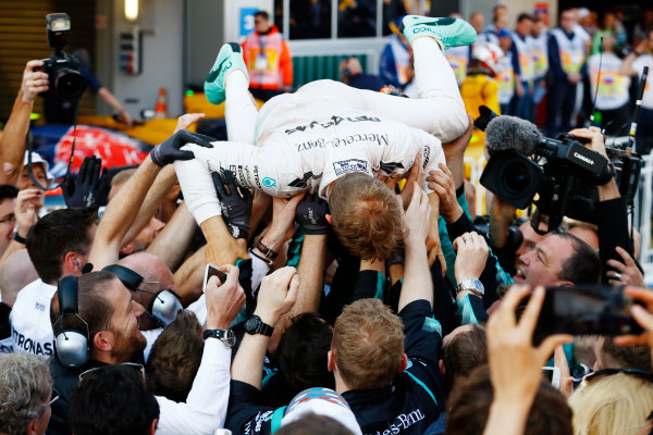 Sochi Autodrom, Sochi, Russia.  Sunday 1 May 2016. Nico Rosberg, Mercedes AMG, 1st Position, surfs a crowd of Mercedes engineers in Parc Ferme. World Copyright: Steven Tee/LAT Photographic ref: Digital Image _H7I3487