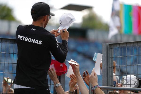 Hungaroring, Budapest, Hungary.  Thursday 27 July 2017. Lewis Hamilton, Mercedes AMG, signs a cap for a fan. World Copyright: Glenn Dunbar/LAT Images  ref: Digital Image _31I7788
