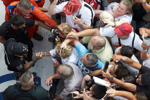 Autodromo Nazionale di Monza, Monza, Italy. Thursday 3 September 2015. Lewis Hamilton, Mercedes AMG, signs autographs for fans. World Copyright: Steve Etherington/LAT Photographic ref: Digital Image SNE23459