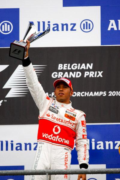 Spa-Francorchamps, Spa, Belgium 29th August 2010 Lewis Hamilton, McLaren MP4-25 Mercedes, 1st position, lifts his trophy on the podium. Portrait. Podium.  World Copyright: Charles Coates/LAT Photographic ref: Digital Image _26Y6803