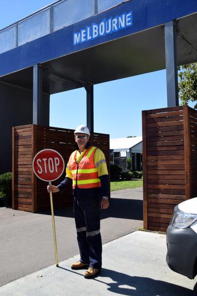 A workman with a stop sign at Albert Park. Formula One World Championship, Rd1, Australian Grand Prix, Preparations, Albert Park, Melbourne, Australia, Sunday 9 March 2014.