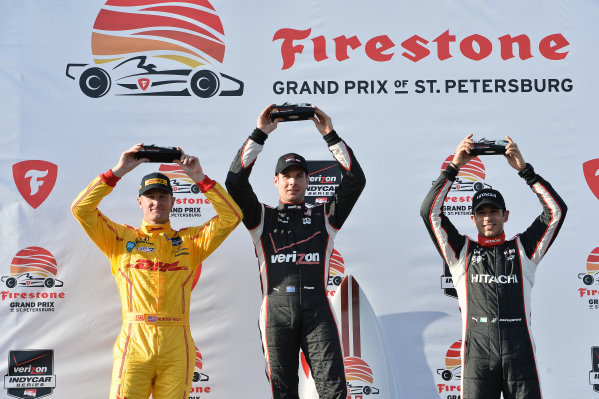 Podium (L to R): Second placed Ryan Hunter-Reay (USA) Andretti Autosport, race winner Will Power (AUS) Penske and third placed Helio Castroneves (BRA) Penske celebrate on the podium. Verizon IndyCar Series, Rd1, Firestone Grand Prix Of St. Petersburg, St. Petersburg, Florida, USA, 29-30 March 2014.