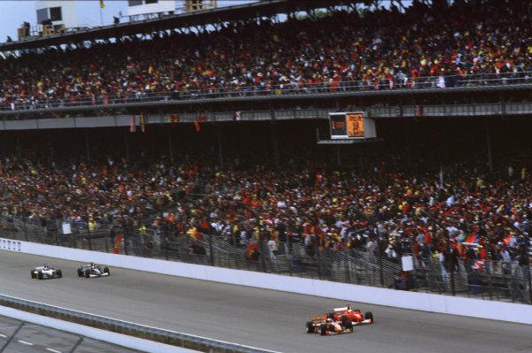 Indianapolis, Indiana, USA. 22-24 September 2000.Rubens Barrichello (Ferrari F1-2000) slipstreams past Jos Verstappen (Arrows A21 Supertec) on the main straight.Ref-2k USA A27.World Copyright - Coates/LAT Photographic