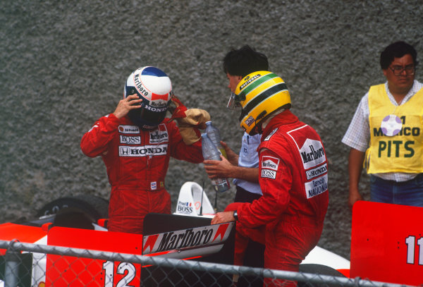 Mexico City, Mexico. 27th - 29th May 1988.Ayrton Senna (McLaren MP4/4 Honda), 2nd position and Alain Prost (McLaren MP4/4 Honda) 1st position, in parc ferme, portrait. World Copyright: LAT Photographic.Ref:  88MEX