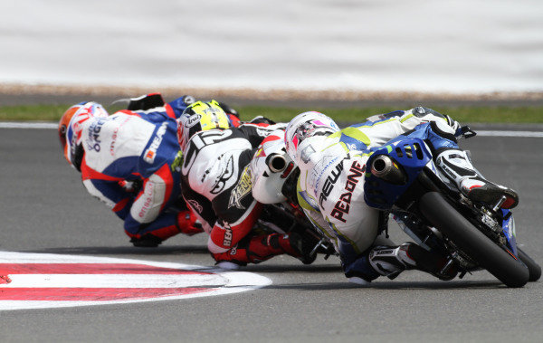 British Grand Prix.  Silverstone, England. 15th-17th June 2012.  Moto3. Kenta Fuji, TSR Honda, and Giulian Pedone, Suter Honda.  World Copyright: Kevin Wood/LAT Photographic.  ref: Digital Image IMG_8738a