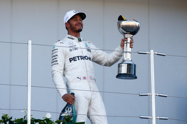 Suzuka Circuit, Japan. Sunday 8 October 2017. Lewis Hamilton, Mercedes AMG, 1st Position, leaves the podium with his trophy. World Copyright: Andrew Hone/LAT Images  ref: Digital Image _ONY8928