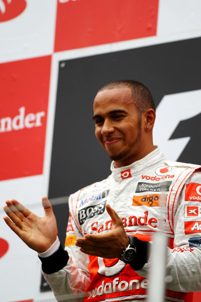 Nurburgring, Germany.24th July 2011Lewis Hamilton, McLaren MP4-26 Mercedes, 1st position, on the podium. Portrait. Podium. World Copyright: Andy Hone/LAT Photographicref: Digital Image CSP13433