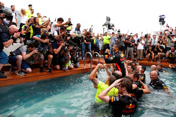 Daniel Ricciardo, Red Bull Racing, celebrates victory in the swimming pool on the Red Bull Energy Station with team members, including designer Rob Marshall, Chief Engineering Officer, Red Bull Racing.
