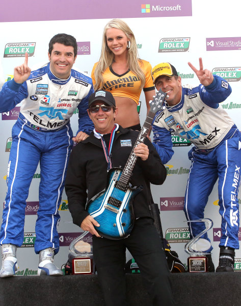18-20 April, 2013, Braselton, Georgia USA Team manager Tim Keene, center, celebrates with drivers Memo Rojas, left and Scott Pruett in victory lane. ©2013, R D. Ethan LAT Photo USA