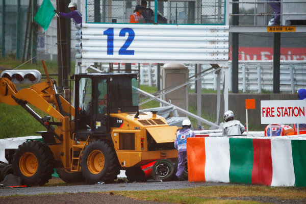 Suzuka Circuit, Suzuka, Japan. Sunday 5 October 2014. Jules Bianchi, Marussia MR03 Ferrari, crashes out of the race and receives urgent medical attention. World Copyright: Andrew Hone/LAT Photographic. ref: Digital Image _ONZ1791