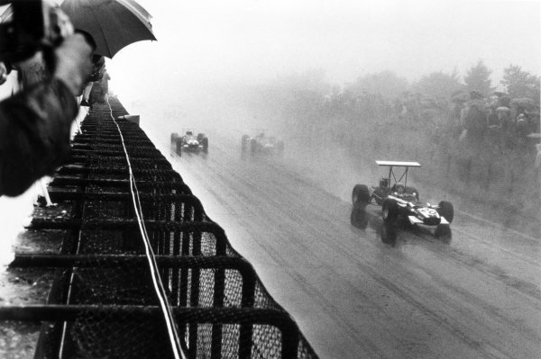 1968 German Grand Prix.Nurburgring, Germany. 4 August 1968.Vic Elford, Cooper T86B-BRM, retired, leads Jack Brabham, Brabham BT26-Repco, 5th position, action in the wet.World Copyright: LAT PhotographicRef: Autocar b&w print