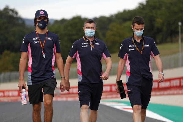 Lance Stroll, Racing Point, walks the track with colleagues
