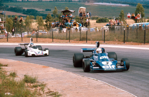 1975 South African Grand Prix.Kyalami, South Africa.27/2-1/3 1975.Jody Scheckter (Tyrrell 007 Ford) 1st position followed by Carlos Reutemann (Brabham BT44B Ford) 2nd position.Ref-75 SA 05.World Copyright - LAT Photographic