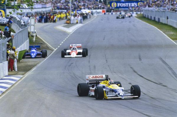 Nelson Piquet, Williams FW11 Honda, leads Keke Rosberg, McLaren MP4-2C TAG, past Piercarlo Ghinzani's stranded Osella FA1F Alfa Romeo.
