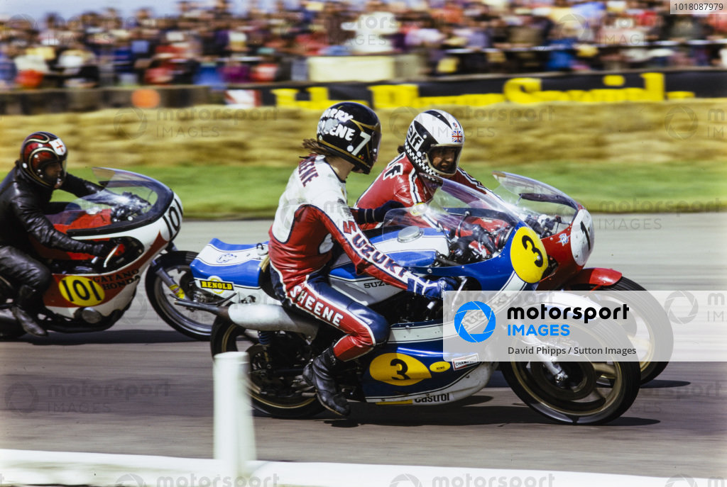 Barry Sheene, Suzuki, looks over at Phil Read, MV Agusta, with Leo Castles, Honda, close behind.