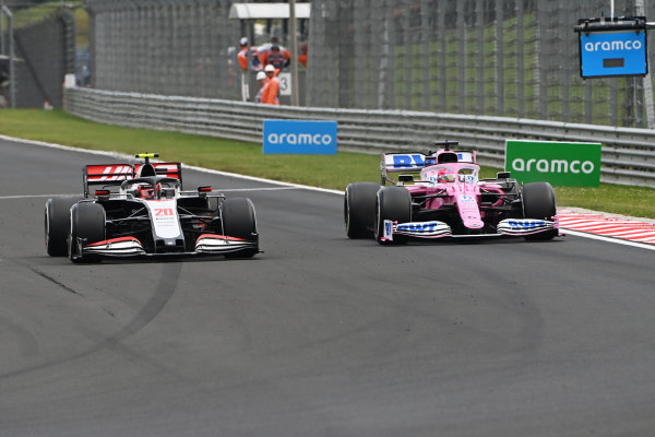 Kevin Magnussen, Haas VF-20, battles with Sergio Perez, Racing Point RP20