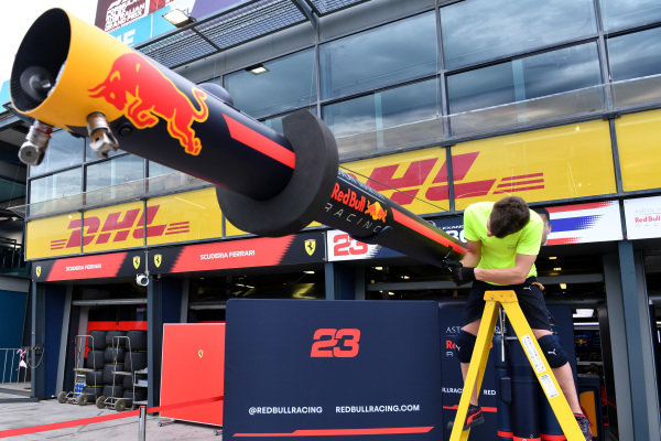 A member of the Red Bull team packs away equipment in the pits
