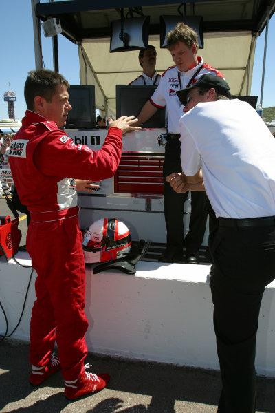 2003 Phoenix IRL IndyCar, 21-23 March 2003; Phoenix International Raceway; Phoenix, Arizona USAGil de Ferran demonstrates how his car was handling to Tim Cindric-2003 Lesley Ann Miller, USALAT Photographic