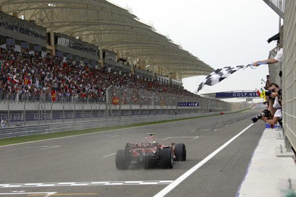 Felipe Massa, Ferrari F2008 takes the chequered flag for victory.