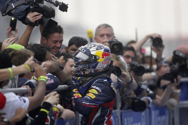 Sebastian Vettel celebrates with the Red Bull team in Parc Ferme.