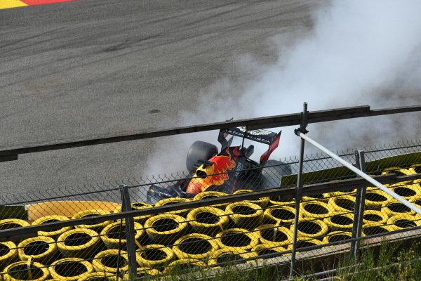 Max Verstappen, Red Bull Racing RB15, spears off the circuit and into a barrier due to damage from a collision with Kimi Raikkonen, Alfa Romeo Racing C38