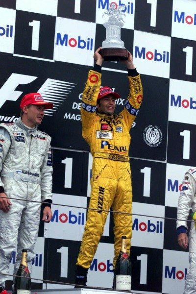 1999 French Grand Prix.Magny-Cours, France.25-27 June 1999. Heinz-Harald Frentzen (Jordan Mugen Honda) celebrates his 1st position on the podium, with Mika Hakkinen (McLaren Mercedes) 2nd position next to him.World Copyright - Coates/LAT Photographic