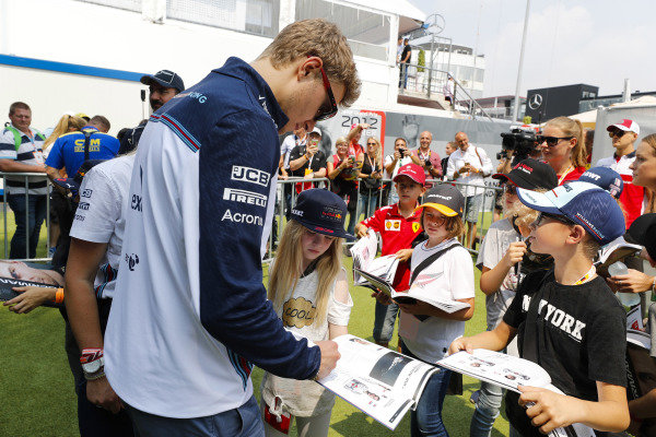 Sergey Sirotkin, Williams Racing, signs autographs for young fans.