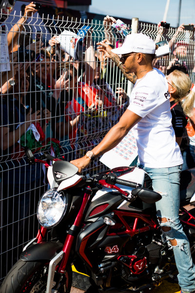 Monte Carlo, Monaco. Wednesday 24 May 2017. Lewis Hamilton, Mercedes AMG, signs autographs for fans whilst astride his motorbike. World Copyright: Sam Bloxham/LAT Images ref: Digital Image _W6I0470