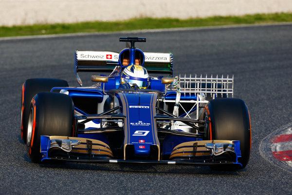 Circuit de Barcelona Catalunya, Barcelona, Spain. Monday 27 February 2017. Marcus Ericsson, Sauber C36 Ferrari, carries sensor equipment. World Copyright: Zak Mauger/LAT Images ref: Digital Image _L0U9713