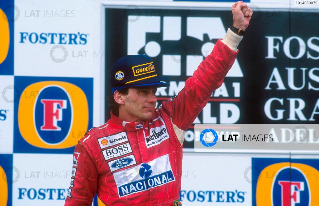 1993 Australian Grand Prix. Adelaide, Australia. 5-7 November 1993. Ayrton Senna (McLaren Ford) celebrates 1st position on the podium. His last Grand Prix win. Ref-93 AUS 01. World Copyright - LAT Photographic