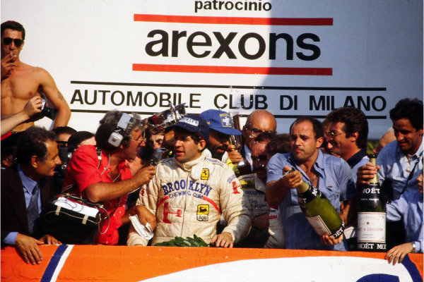 Jody Scheckter is interviewed on the podium after claiming victory.