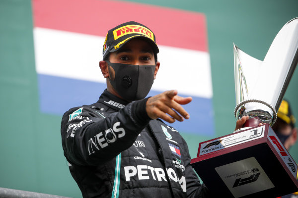 Race Winner Lewis Hamilton, Mercedes-AMG Petronas F1 celebrates on the podium with the trophy