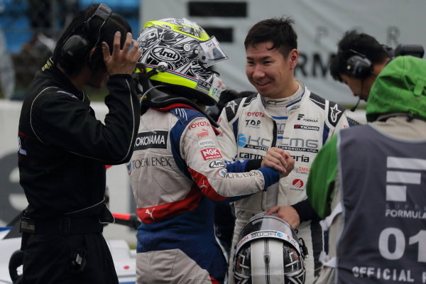 Winner Yuhi Sekiguchi, Itochu Enex Team Impul SF14 Toyota, is congratulated by second position Kamui Kobayashi, carrozzeria Team KCMG SF14 Toyota, in parc ferme.