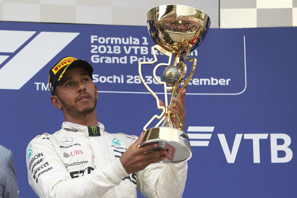 Lewis Hamilton, Mercedes AMG F1 with the trophy on the podium