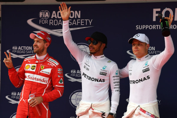 (L to R): Sebastian Vettel (GER) Ferrari, pole sitter Lewis Hamilton (GBR) Mercedes AMG F1 and Valtteri Bottas (FIN) Mercedes AMG F1 celebrate in parc ferme at Formula One World Championship, Rd2, Chinese Grand Prix, Qualifying, Shanghai, China, Saturday 8 April 2017.