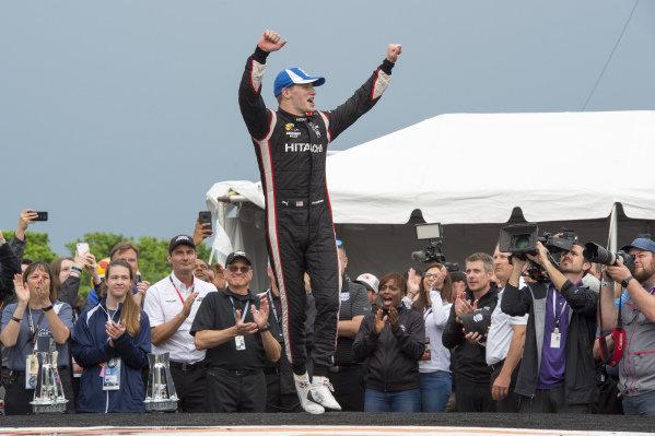Josef Newgarden, Team Penske Chevrolet celebrates win on victory platform