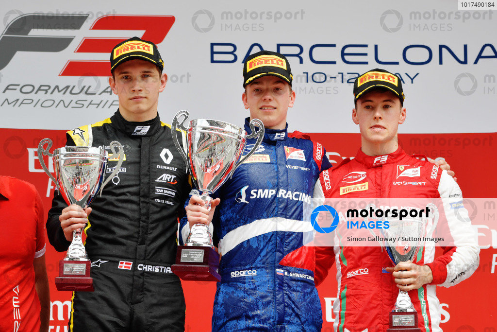 Robert Shwartzman (RUS) PREMA Racing, celebrates on the podium with Christian Lundgaard (DNK) ART Grand Prix, and Marcus Armstrong (NZL) PREMA Racing