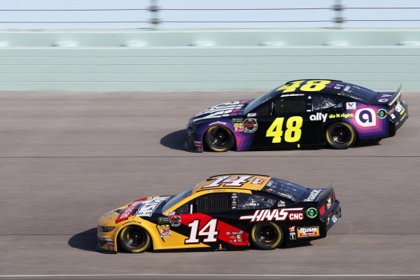 #14: Clint Bowyer, Stewart-Haas Racing, Ford Mustang Rush Truck Centers / Haas CNC #48: Jimmie Johnson, Hendrick Motorsports, Chevrolet Camaro Ally
