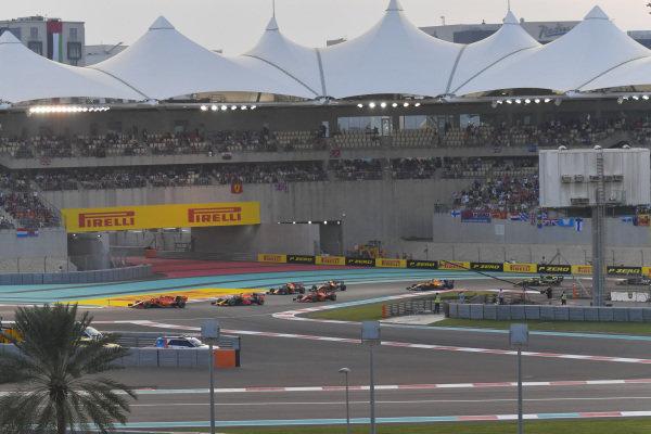 Charles Leclerc, Ferrari SF90, leads Max Verstappen, Red Bull Racing RB15, Alexander Albon, Red Bull RB15, Sebastian Vettel, Ferrari SF90, Lando Norris, McLaren MCL34 and Carlos Sainz Jr., McLaren MCL34