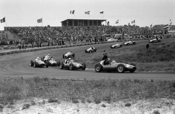 Mike Hawthorn, Ferrari 555, leads Maurice Trintignant, Ferrari 555, while Roberto Mieres, Maserati 250F, battles with Eugenio Castellotti, Ferrari 555.