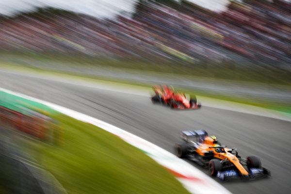 Lando Norris, McLaren MCL34, leads Carlos Sainz Jr., McLaren MCL34
