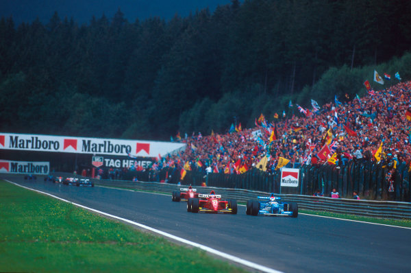 Spa-Francorchamps, Belgium.25-27 August 1995.Jean Alesi (Ferrari 412T2) battles with Johnny Herbert  (Benetton B195 Renault) for the lead with Gerhard Berger (Ferrari 412T2) behind.Ref-95 BEL 12.World Copyright - LAT Photographic