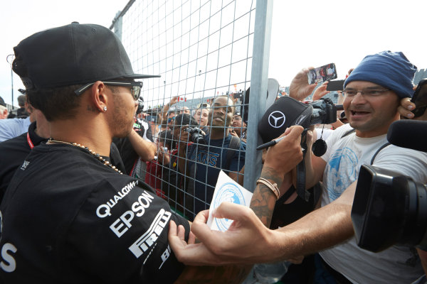 Circuit Gilles Villeneuve, Montreal, Canada. Sunday 7 June 2015. Lewis Hamilton, Mercedes AMG, signs autographs for fans. World Copyright: Steve Etherington/LAT Photographic. ref: Digital Image SNE21132