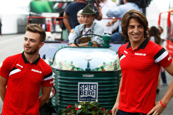 Red Bull Ring, Spielberg, Austria. Thursday 18 June 2015. Will Stevens, Manor F1, and Roberto Merhi, Manor F1, pose in front of a decorative tractor. World Copyright: Sam Bloxham/LAT Photographic. ref: Digital Image _G7C3092